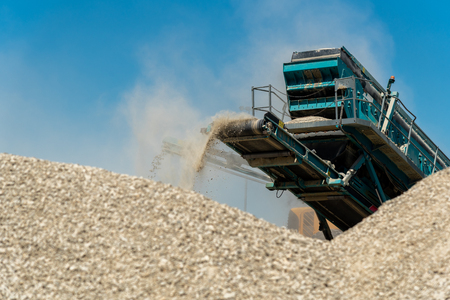 Close view on the machine working in the stone mine
