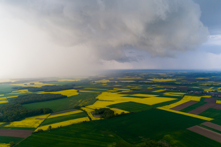 Aerial view on the dangerous clouds above the small village