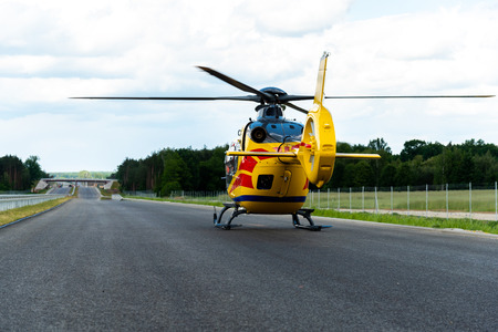 Rescue helicopter taking off from the route with the patient onboard