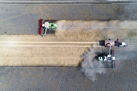 Aerial view on the harvester working on the field and filling the truck Stock fotó - 104726697