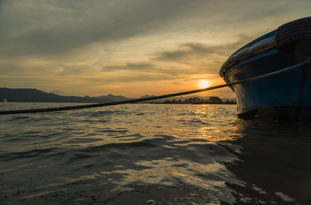 dignified: sunset with boat at the sea
