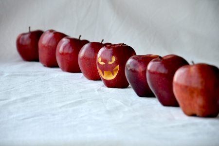 extraordinary: An extraordinary apple is in the line of red apples Stock Photo