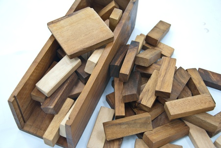 Building and scattered from wooden blocks - Isolated on white background  photo