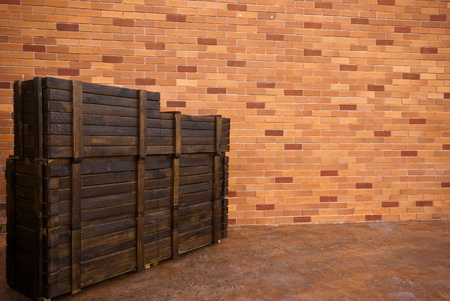 modern brick wall background with old wooden  boxes photo