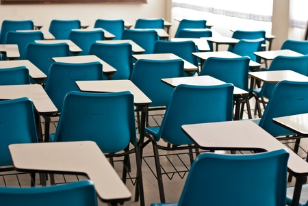 attend: Interior of a college in empty lecture hall - Classroom in a university Stock Photo