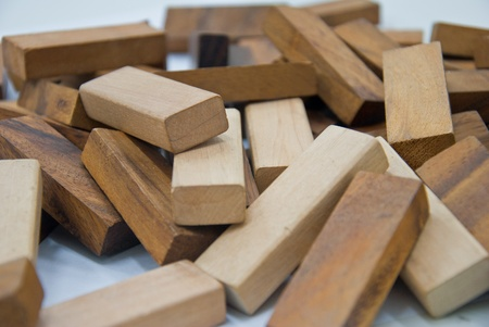 Building and scattered from wooden blocks toys - Isolated on white background  photo