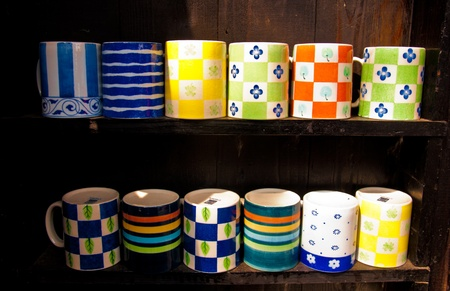 big colorful cup glass on wooden shelves with different light - prepare to drink photo