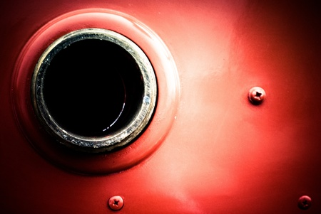 vintage fire hydrant hole on the fire truck with three bolts Stock Photo
