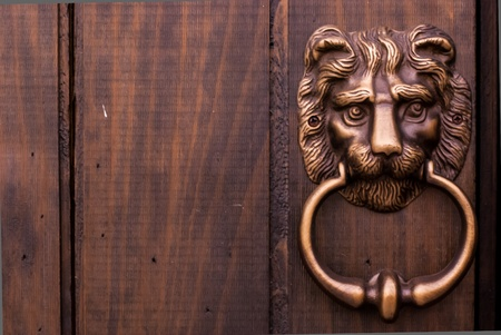 Bronze kind lion door knocker the chinese traditional on wooden door - door knocker in shape of lion head Stock Photo - 13272136