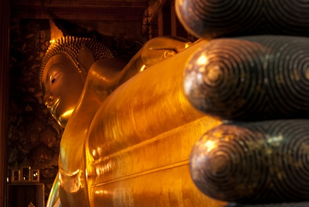 Golden Reclining Buddha - Face of Golden Reclining Buddha in Thailand,Wat Pho, Bangkok photo