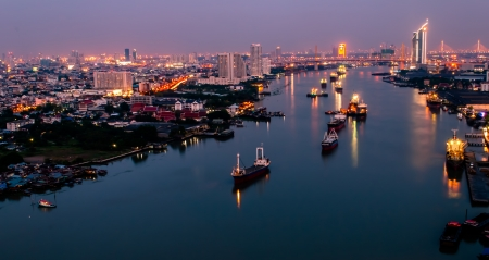 View across Bangkok city at twilight nearly river