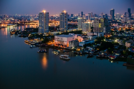 View across Bangkok city at twilight nearly river photo