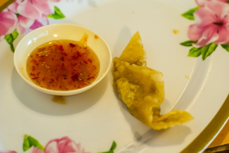 potstickers: Fried Potstickers, Dumplings, Traditional Asian Food, Stuffed with Pork Meat or Vegetables - Fried Dumplings Chinese Style Cuisine as Meal - A chinese dumpling appetizer on white with pink rose plate