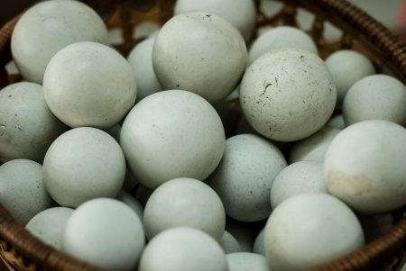 Many of white almost circle stone texture like eggs in the basket - Background of stone