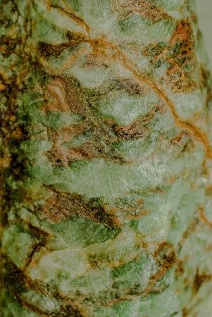 roughness green stone texture with orange and brown lines like a emerald photo