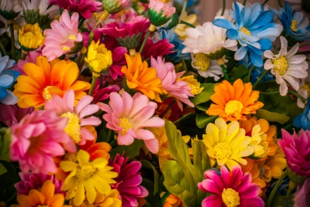 soft sell: Many colorful cotton fabric flowers
