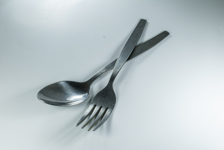 silver spoon and fork in shallow focus close up - isolated on white background Stock Photo - 14269760