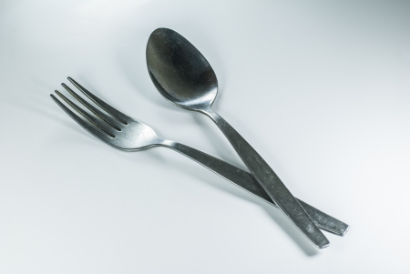 silver spoon and fork in shallow focus close up - isolated on white background Stock Photo - 14269757