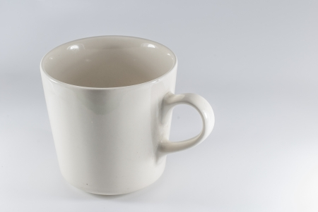 White cup of coffee on white background - Empty cup, close-up - Isolated Stock Photo
