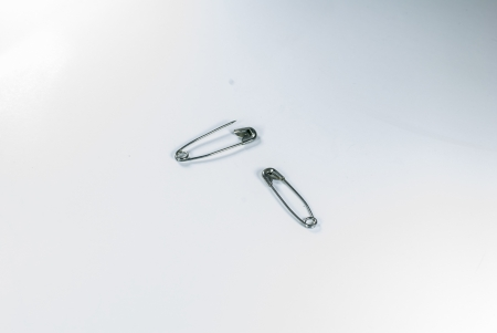 sheeny: Safety pin - isolated - Two safety pins over white background -  Stock Photo