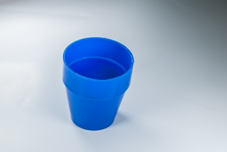 throwaway: Plastic Cups on White Background -  Plastic cups of blue color isolated on white - Empty cup