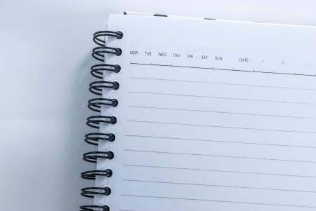 Blank notebook with date and day - White paper texture background photo