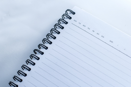 Blank notebook with date and day - White paper texture background Stock Photo - 14325876