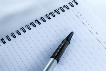 Blank notebook with date and day - White paper texture background - Ballpoint pen on checked notebook paper Stock Photo - 14369680