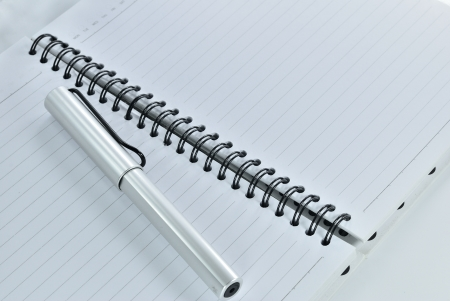Blank notebook with date and day - White paper texture background - Ballpoint pen on checked notebook paper Stock Photo - 14369686