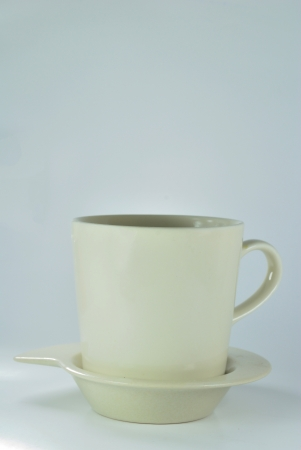 White cup of coffee and small spoon on white background - Empty cup, close-up - Isolated photo