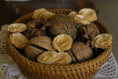 yellow dead roses and coconut shell in the wooden basket - Wilted rose - Old dried red rose - dry yellow rose and dry coconut photo