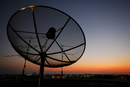 Worldwide Communication, Satellite and other antenna network with beautiful sky in evening