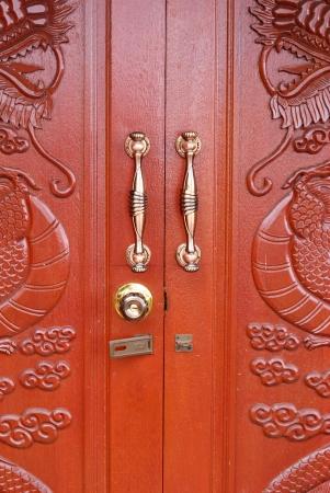 Doors with dragon pattern and handles - wood door - Wooden door texture background - ancient wood carvings door photo