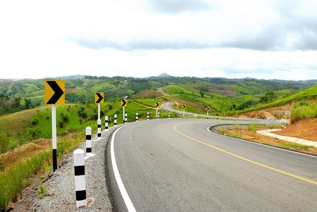 beautiful mountain with zigzag road line - Rural road -  Asphalt road in countryside - Road to mountains - curve s shape road go to hill - Twisty High Alpine Road photo