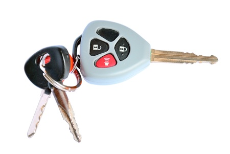 Car key with remote buttons on white background - Car ignition key with remote control photo