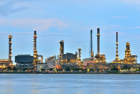 Oil refinery at twilight - Petrochemical factory -Oil and gas refinery at twilight photo
