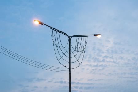 super highway: Streetlight on blue sky - super highway lighting column at evening - Street lamp and blue sky