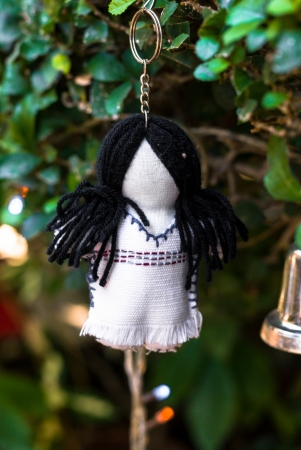 A girl doll decoration hangs on a branch of a tree Stock Photo - 17073374