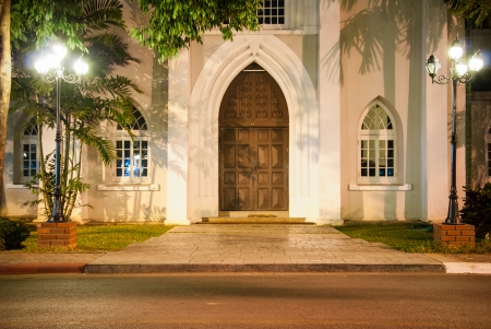 Entrance to the church with beautiful light and shade at night - old wooden Church Door photo