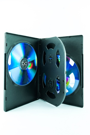 Black Case for DVD Or CD Disk with DVD Or CD Disk isolated on white background - the CD in the package - Black compact disk photo