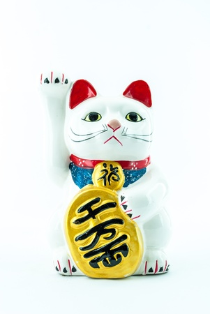Maneki Neko (Japanese Welcoming Cat, Lucky Cat, Cat Swipe, Money cat, or Fortune Cat) -  An ancient cultural icon from japan and popular - Lucky cat photo