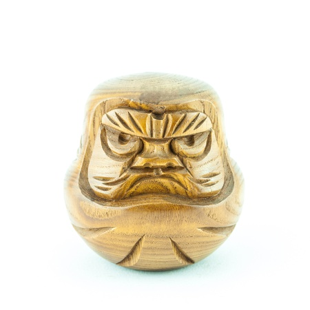 angry wooden dol - wooden doll on a white background photo