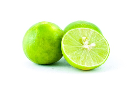 Green fresh lime and slice, Isolated on white background - Fresh limes Isolated on white photo