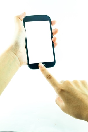Cell phone with touchscreen in female hand on white background - female hand is holding a modern touch screen phone - blank white screen photo