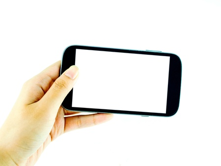 Cell phone with touchscreen in female hand on white background - female hand is holding a modern touch screen phone - blank white screen Stock fotó