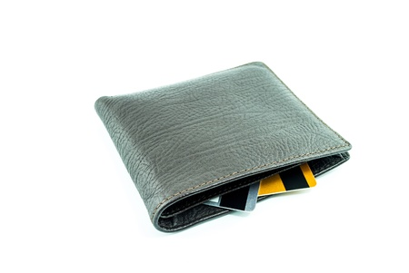 brown wallet with credit cards on a white background photo