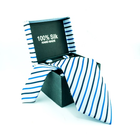 black box from which hangs a tie white background, isolated - Modern tie in a open box photo
