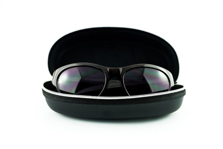 Purple sunglasses in black case isolated on white - sunglasses and case on a white background - eyeglasses in box