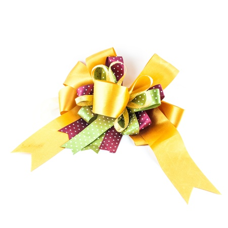 golden or yellow ribbon bow isolated on white background - single gift bow, golden satin photo