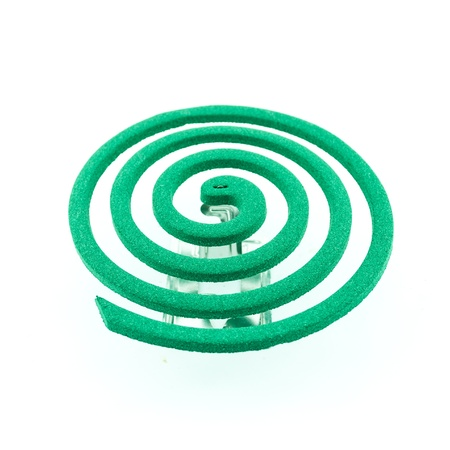mosquito coil -  Anti mosquito green color - insecticides, coils - anti mosquito smoke spiral isolated on the white background photo